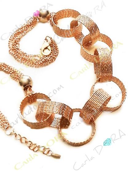 collier fantaisie anneaux or scintillant