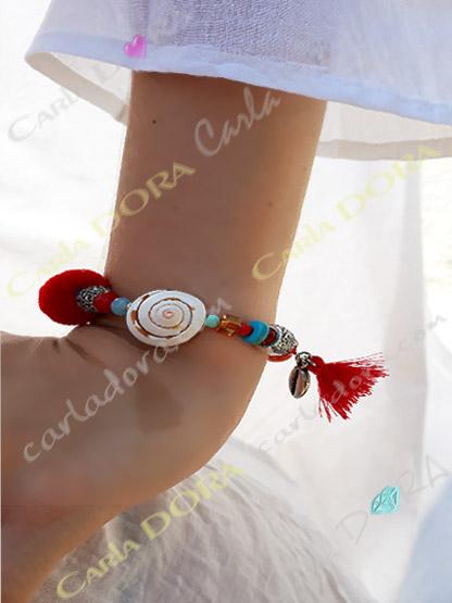 bracelet fantaisie femme elastique coquillage pompon perles et metal